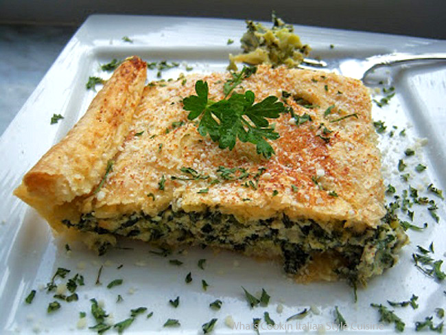 this is a puff pastry dough filled and baked with spinach and broccoli with eggs and cheese Italian style