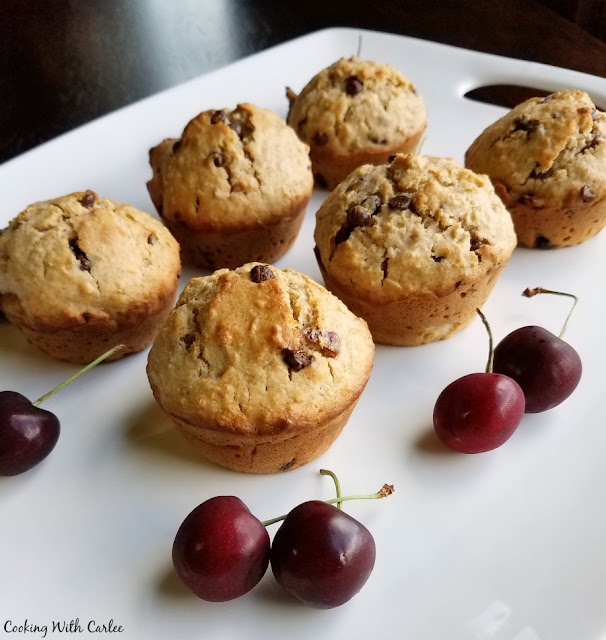 cherry chip muffins on platter with fresh sweet cherries
