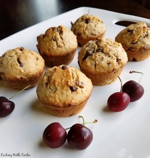 cherry chip muffins on platter with fresh sweet cherries