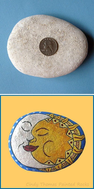 Moon and Sun Faces painted on a rock by Cindy Thomas