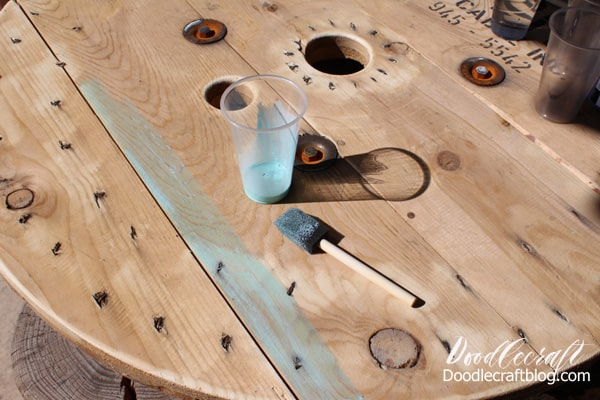 Paint an upcycled table with a blue ombre wash.