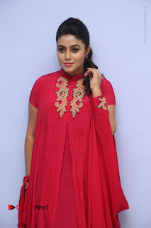 Poorna Latest Stills in Red Dress at Rakshasi First Look Launch