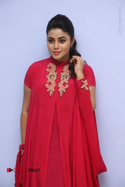 Actress Poorna Latest Stills in Red Dress at Rakshasi First Look Launch  0031.JPG