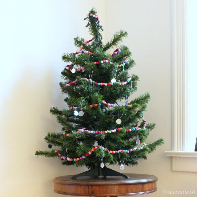 pompom garland on a Christmas tree