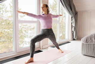 Warrior Pose yoga pose to tone thighs