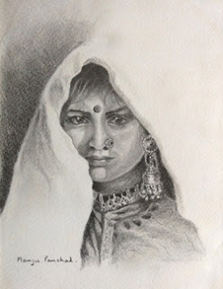 Pencil portrait of an Indian woman's face using graphite pencil. By Manju Panchal