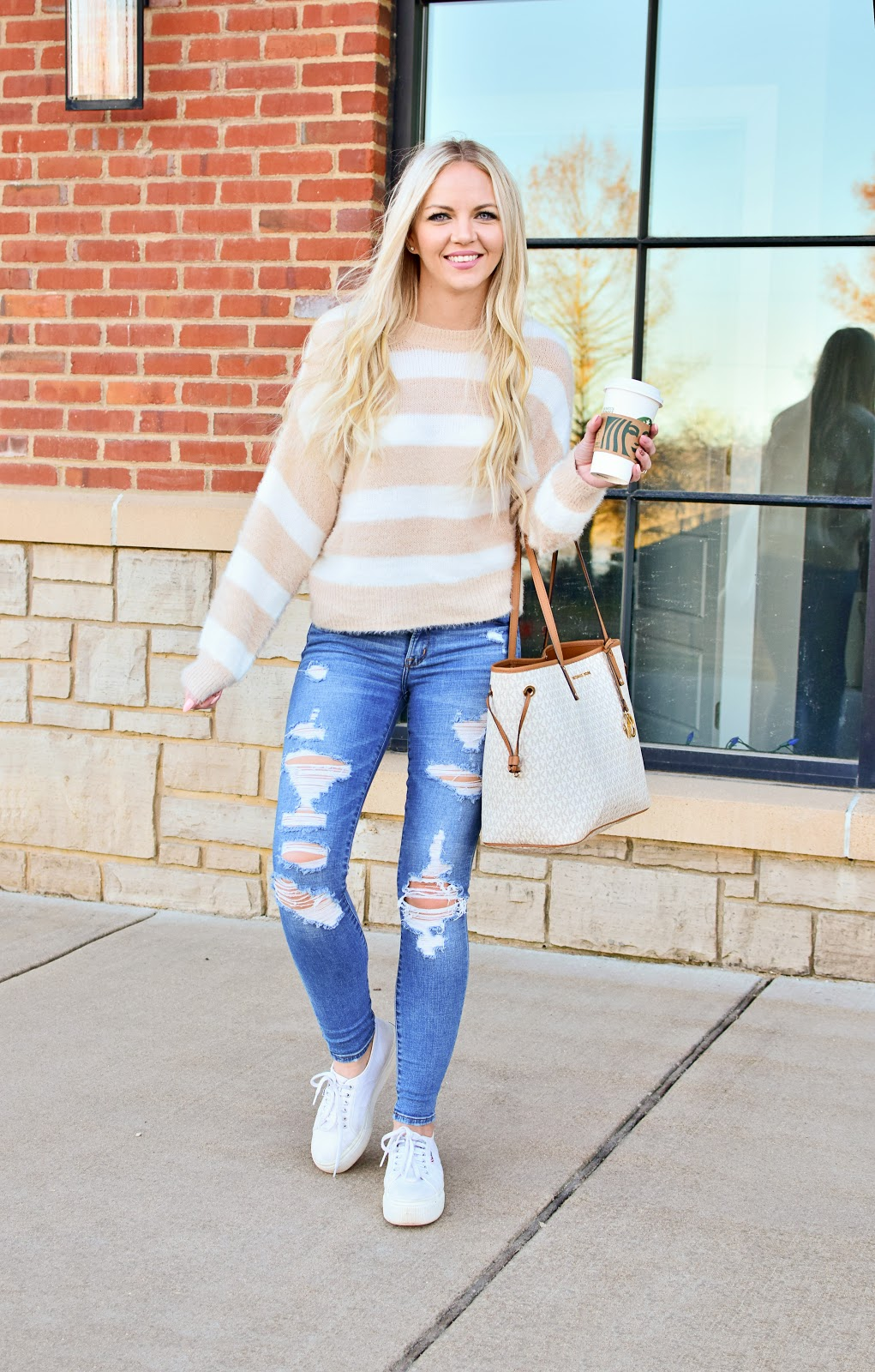 Spring Style 2020 Outfit Sweater Striped Fluffy Fuzzy Soft Sweater Beige Cream Denim Black High Waist Jeans Denim Ripped Knee Gucci Belt Dupe Louis Vuitton Neverfull MM Bag Dupe Tote Michael Kors Logo Jet Set Tote White Skinny Jeans Ugg Mini Fluff Boots Superga Platform Sneakers Sam Edelman Knee High Boots Target Find Wild Fable Abercrombie Jeans Starbucks Blogger Style Mom Blogger Mommy Blogger Mom Style Millennial Style