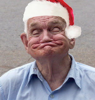 funny old man wearing a santa hat