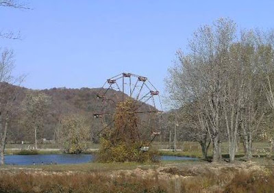 The abandoned Ferris wheel at the site of a dilapidated amusement park along the shore of Lake Shawnee in West Virginia.  The park is believed to be one of the most haunted places in West Virginia.