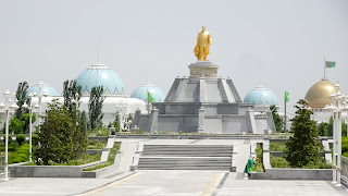 It always turns towards the sun. Its the statue of Turkmenbashi