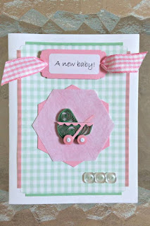 quilled card with baby carriage and gingham ribbon