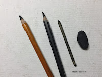 Charcoal pencils, blending tool and kneaded eraser