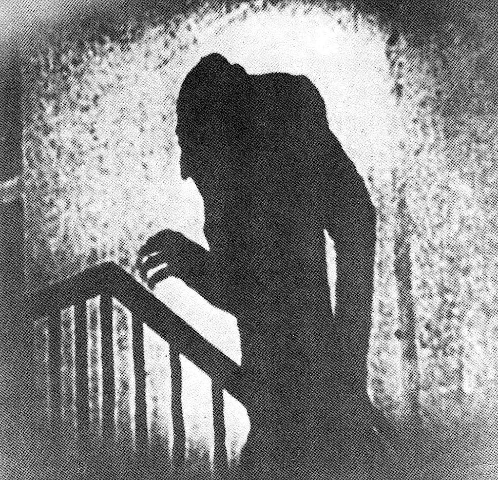 1910s Nosferatu profile in shadow climbing stairs