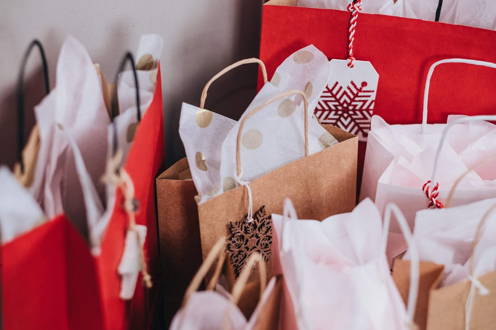 a group of festive shopping bags