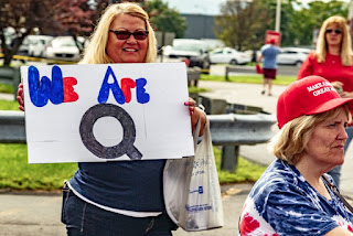 Followers of the QAnon movement regularly show their support for Donald Trump at his political rallies, including this one held in Pennsylvania in 2018.