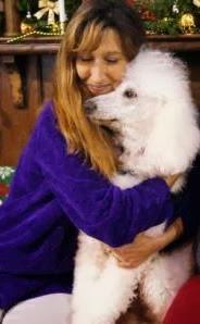 Bunny giving Carma Poodale a hug