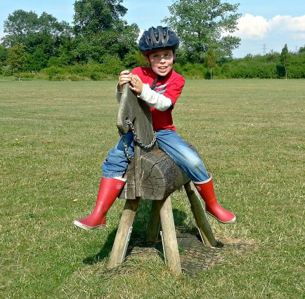 Boy on wooden Horse