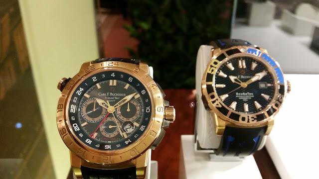 Bucherer Uhren: Ein Modell mit Ziffernblatt in gold-schwarz, und schwarz blau. Sportlich, Männer Spielzeug