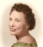 A portrait of a woman with short brown hair in a green dress - Mary Golda Ross.