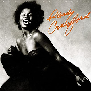 Randy Crawford laughing in an evening dress.