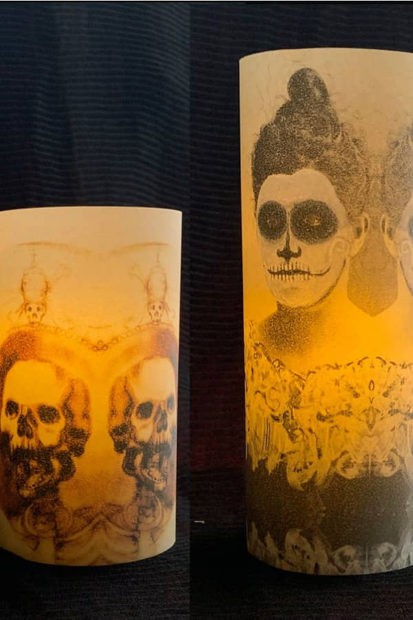 two vellum Halloween luminaries feature scary images