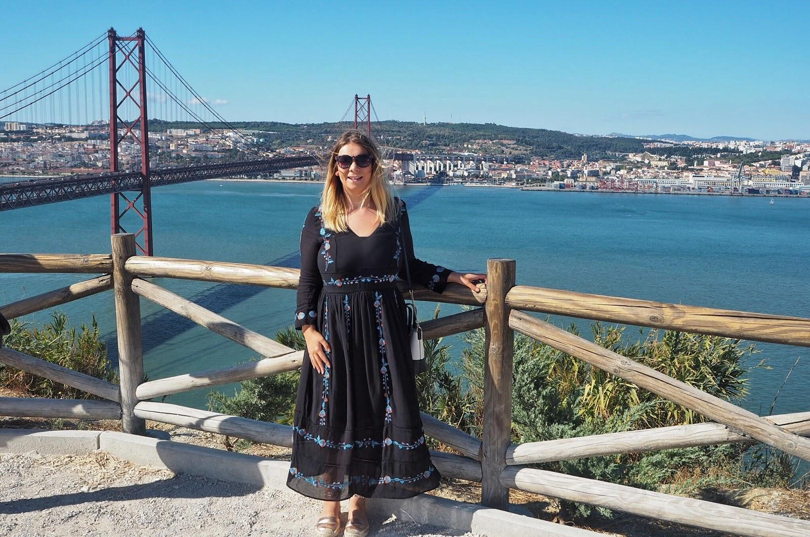Doing it for the gram - posing near Lisbon's 25 de Abril bridge