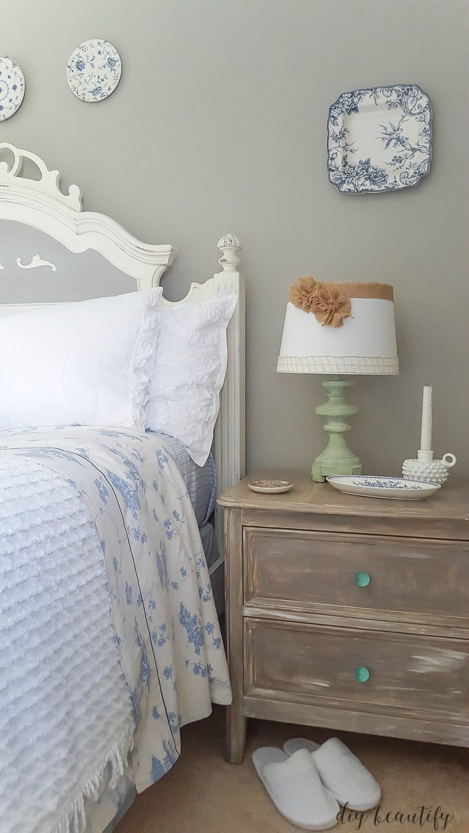 driftwood nightstand in blue and white room