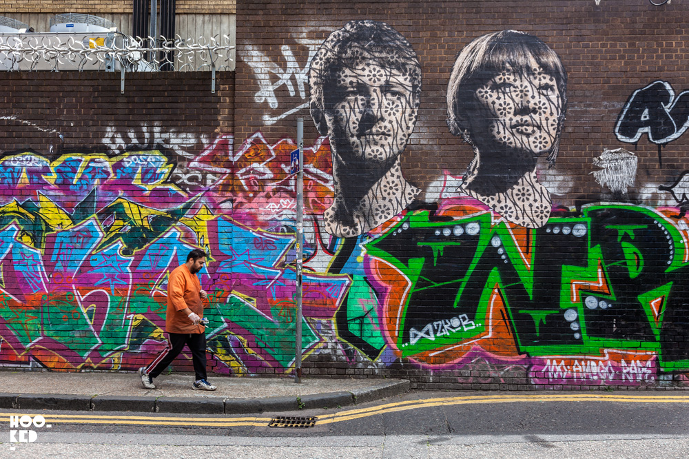 Street Artist Donk's large portraits on Grey Eagle Street, London.