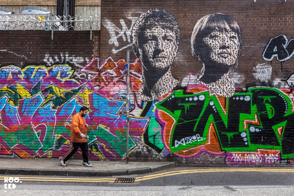 Street Artist Donk's large portraits on Grey Eagle Street, London.