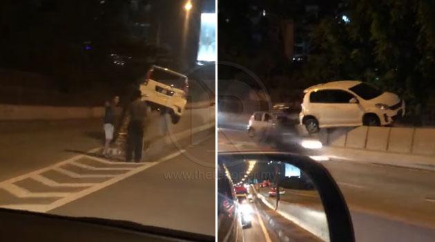 (Video) 'Aku U-Turn semata-mata nak tengok Myvi tu aduhai. Haha!' - Netizen terkejut tengok Myvi panjat divider