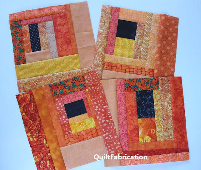 orange quilt blocks with a off center black square