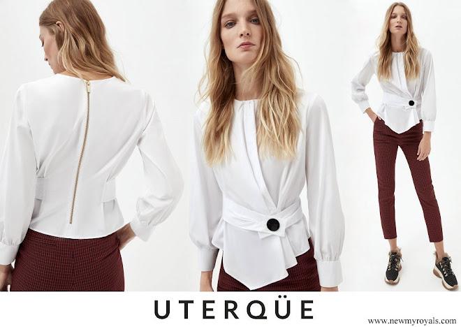 Queen Letizia wore Uterque white shirt with snap button detail