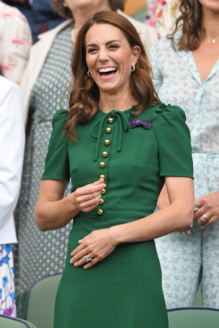 Kate Middleton in solid green suit dress power dressing at Wimbledon 2019
