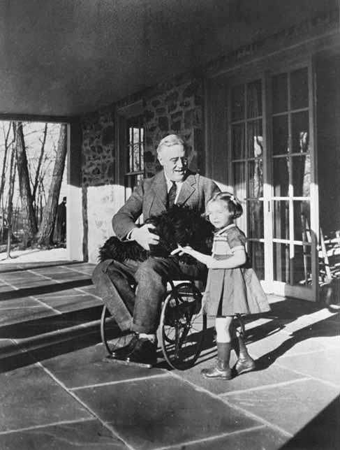 photo of president roosevelt in a wheelchair, dog on his lap, little girl by his side