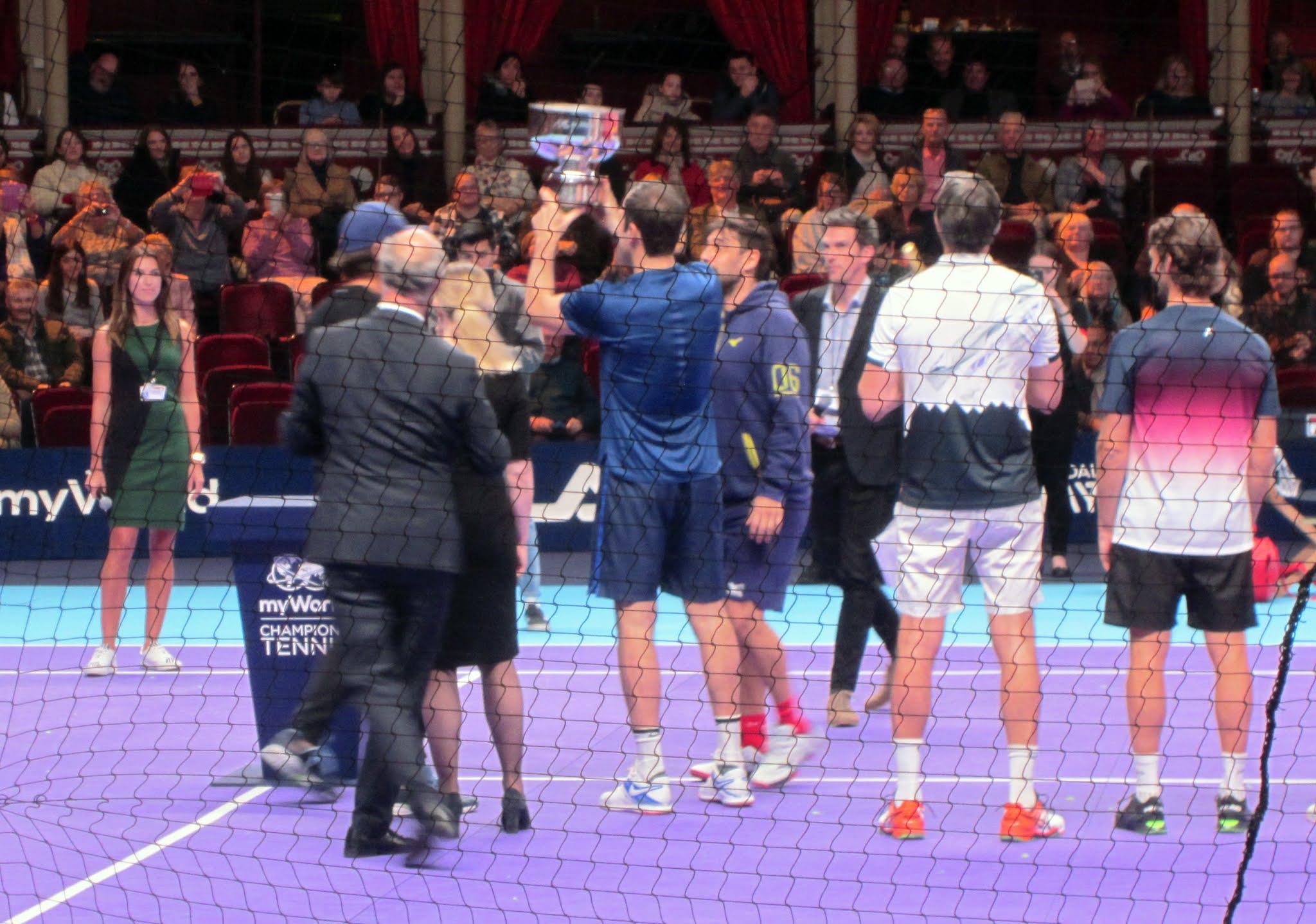 Greg Rusedski lifts the myWorld Champions Tennis trophy at the Royal Albert Hall