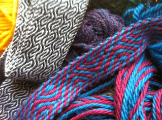 A photograph of two tablet woven bands made using the pattern above