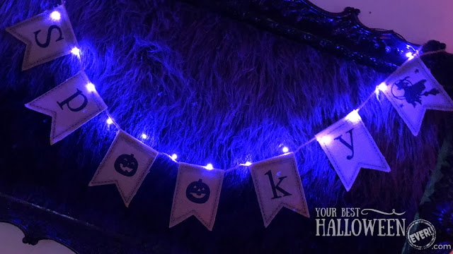 spooky Halloween burlap banner on a framed fuzzy fur art piece with purple fairy lights