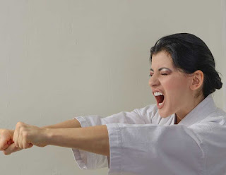 Lady in the middle of a martial arts pose