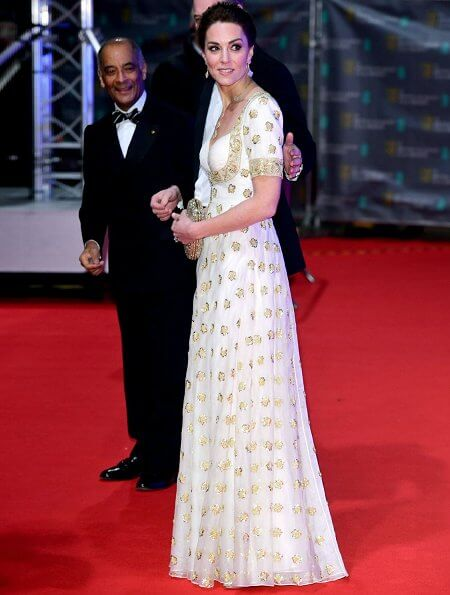 The Duchess wore a gown by Alexander McQueen. Jimmy Choo Romy gold pumps, She carries Anya Hindmarch gold glitter box clutch
