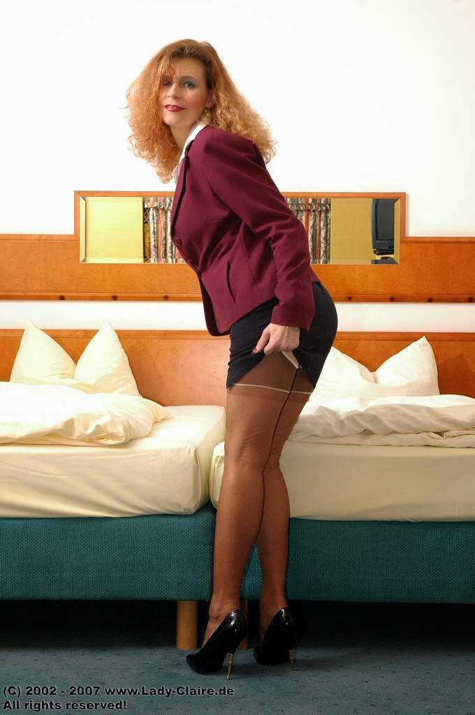 Classy Lady Claire: German redhead Lady Claire in stockings