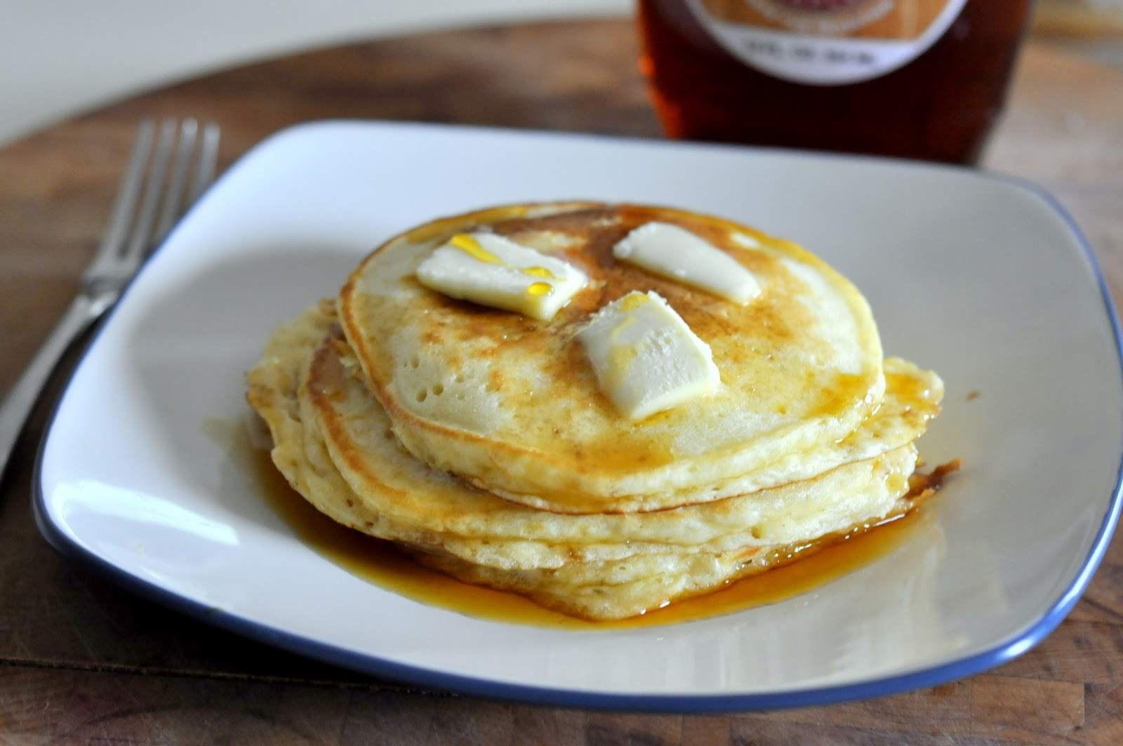 Plate of homemade pancakes with butter and maple syrup | Taste As You Go