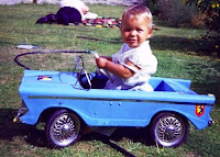 Toddler in a pedal car