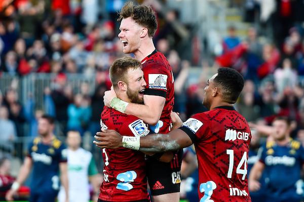 George Bridge celebrates scoring with Sevu Reece and Mitchell Drummond