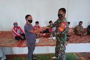 Babinsa Koramil 06/Muara Siau Dampingi Penyaluran BLT-DD Tahap II Desa Tanjung Beruggo