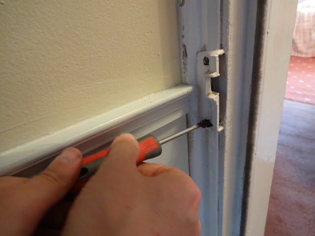 how to remove painted shut lock