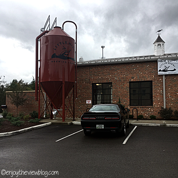 Red brick building with red fermentor that says Little Miami Brewing Company