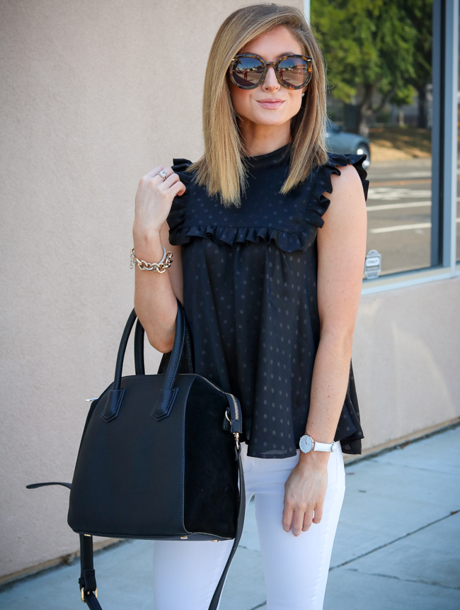 black hinge bib top with white articles of society jeans
