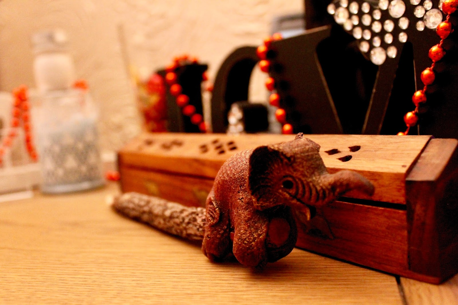 Wooden Interior With Festive Red Beads