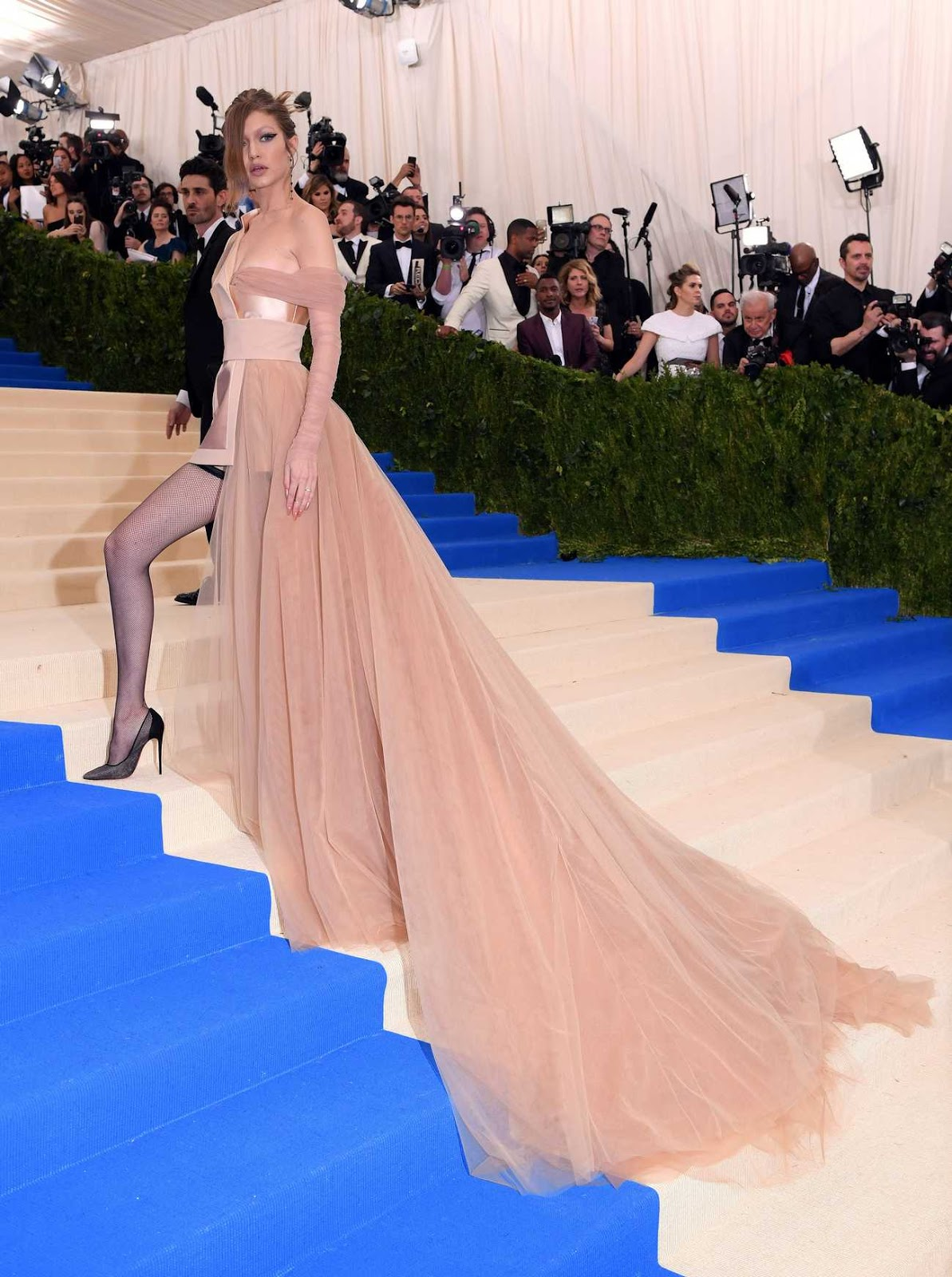 Gigi Hadid turned heads in golden Tommy Hilfiger while attending the Met Gala on Monday