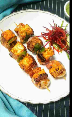 Paneer tikka in a garnished plate